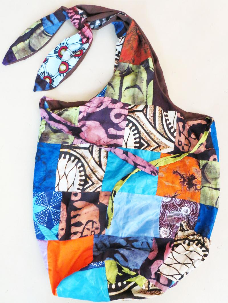 Tie-strap patchwork sling bag