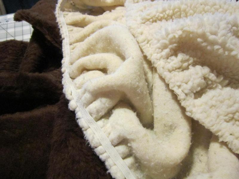 Types of fleece, one with elastic sewn onto it.