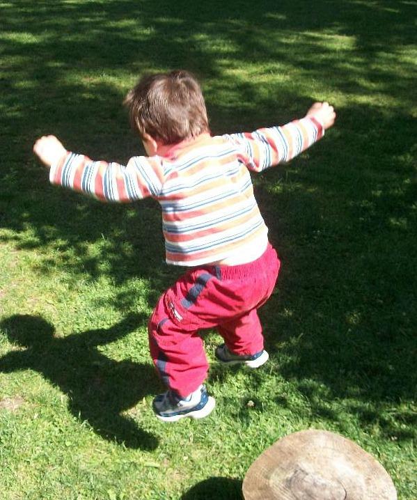 Child Jumping off Tree Stump