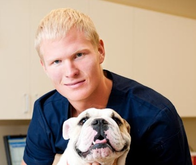 Stock photo Blond guy with bulldog