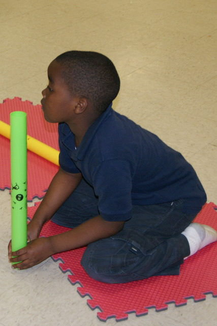 One student waits for his cue to play.