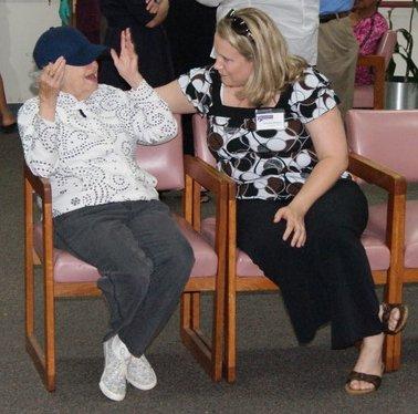 Volunteer visits with senior