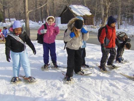 CHildren snowshoeing