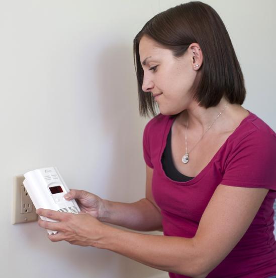 Customer installing carbon monoxide detector