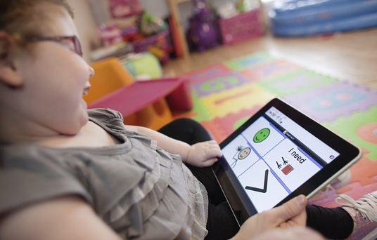 girl with iPad as AAC