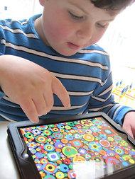 boy interacting with iPad