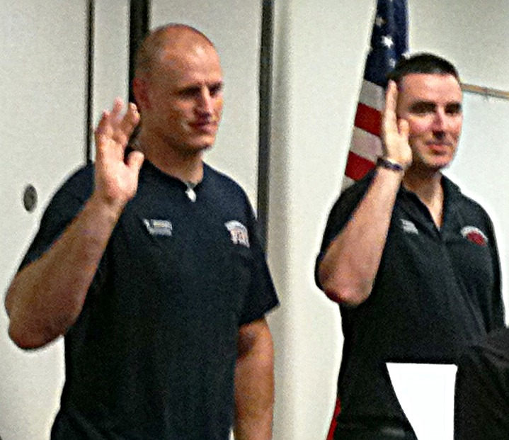 Kyle Green and Terry Evans take their oaths.