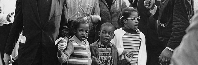 Abernathy children (Donzaleigh, Ralph David, and Juandalynn) march on the front line, followed by Dr. and Mrs. Martin Luther King, leading the Selma to Montgomery March in 1965, Abernathy Family Photos.
