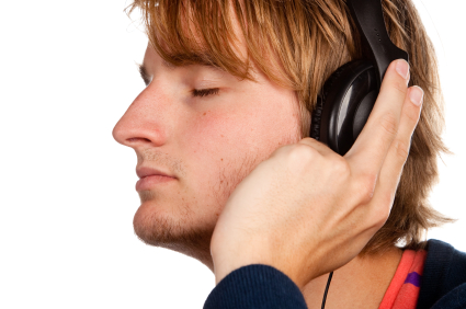 man eyes closed headphones