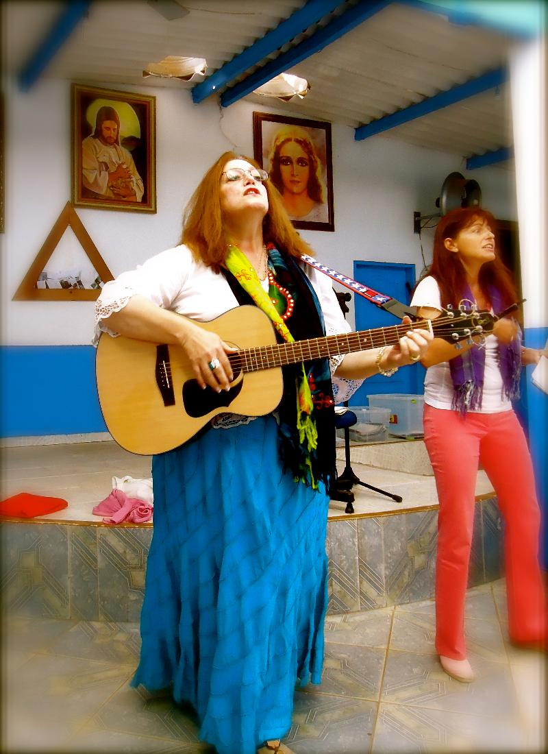 Rev. Nettie leading music for Sunday service at the Casa, 2011
