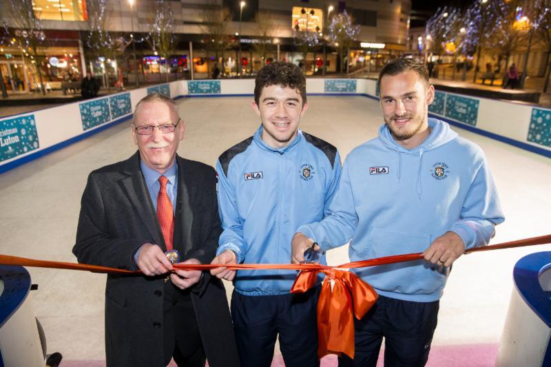 football players and mayor at skating rink launch