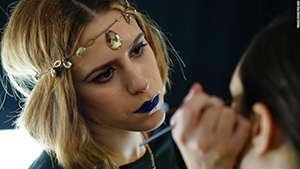 A makeup artist works her magic before the FTL Moda + Art Hearts Fashion, a show that celebrates Italian style.