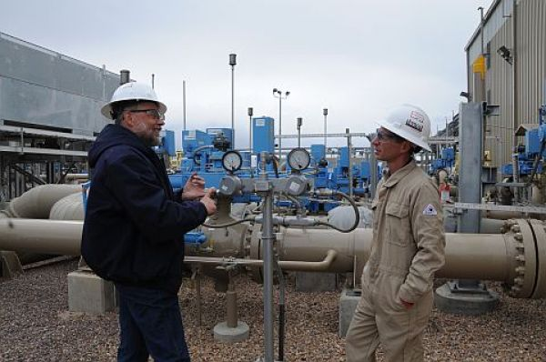 CSU Engines and Energy Conservation Lab workers at a gas gathering and proc