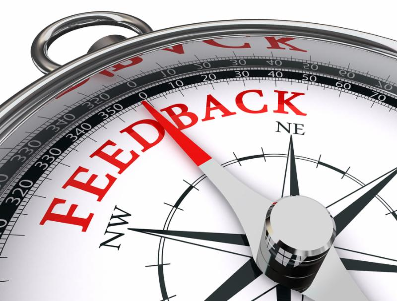 feedback red word on conceptual compass on white background