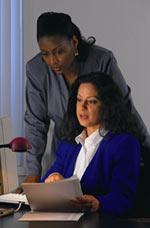 2 women reviewing finances