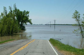 road disappearing into flooded area