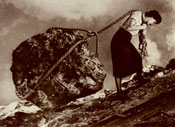 woman hauling boulder uphill