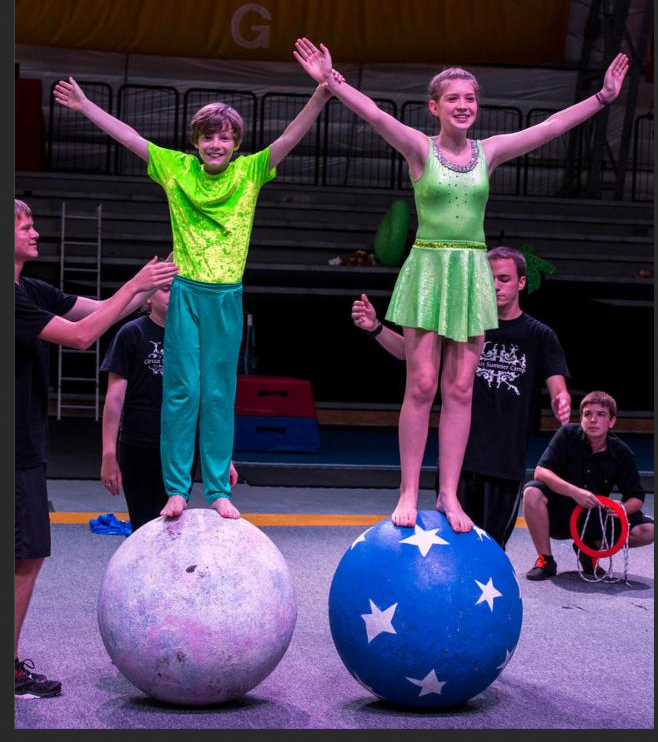 Summer campers learninghow to balance on globes