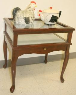 Display case with mahogany finish