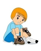 Boy tying shoes