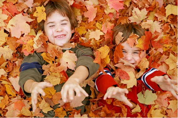 kids in autumn leaves