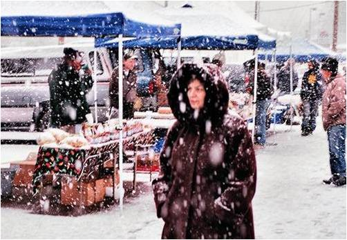 woman in market in the snow