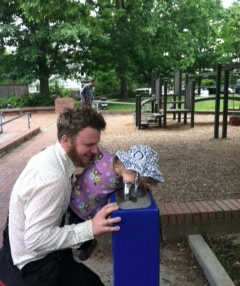 Bill Crawford and his daughter enjoy the water fountain they helped bring to Piccolo Park