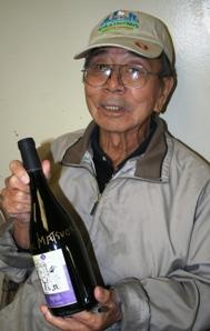 Jack Matsuoka holds up the JAMsj wine