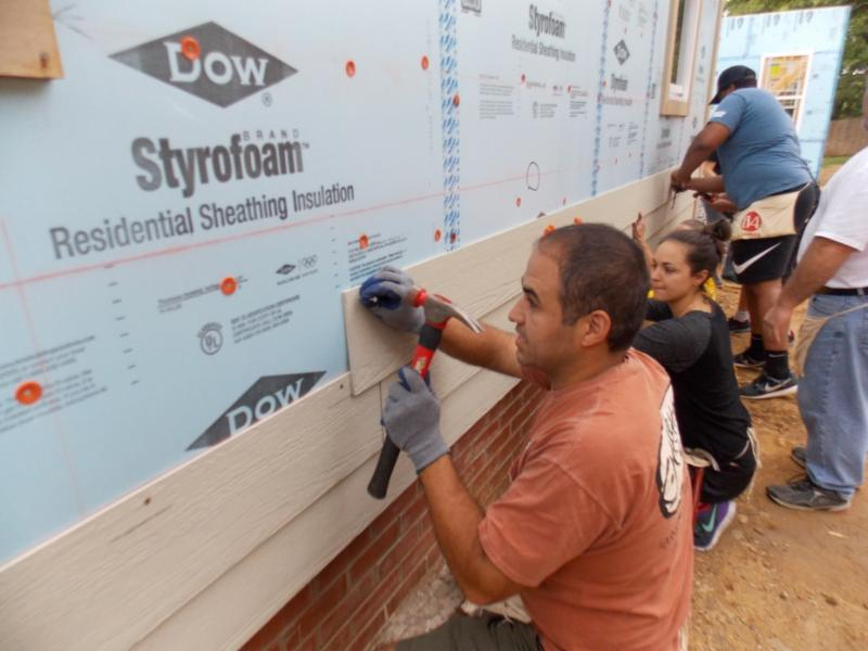 Volunteers work on Habitat home