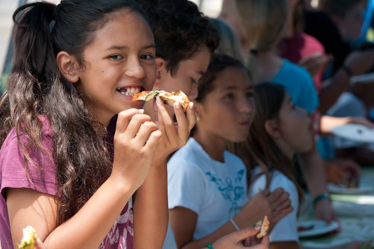 Pizza eaters with Grow Some Good, a school garden organization on Maui, HI
