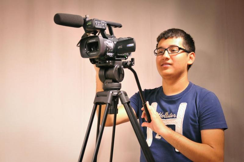 Media Tech student gets ready to film
