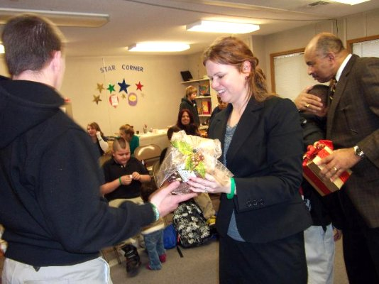 TCP studnets give presents to fellow & judge