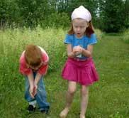kids walking in grass