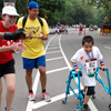 Achilles Kids member cruising to H&P Finish LIne