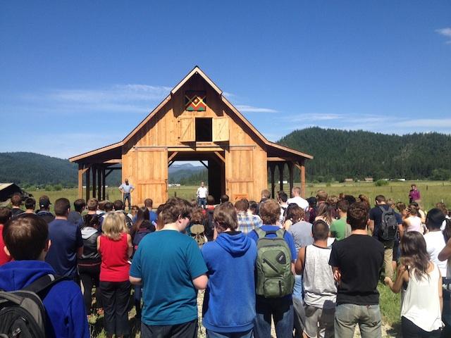 students gather at barn