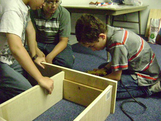 boys building bookcase