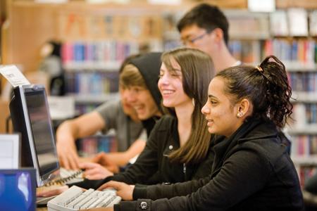 Teens using computer