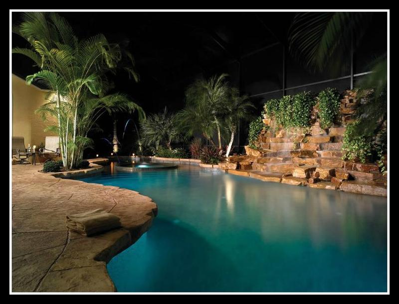 Night view pool, spa & rock waterfall
