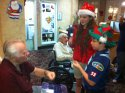 Cole Y of Pack 38 and his sister bring Holiday joy.