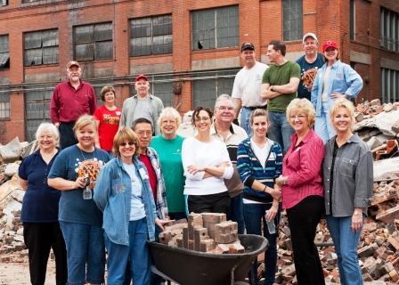 Volunteers bricks