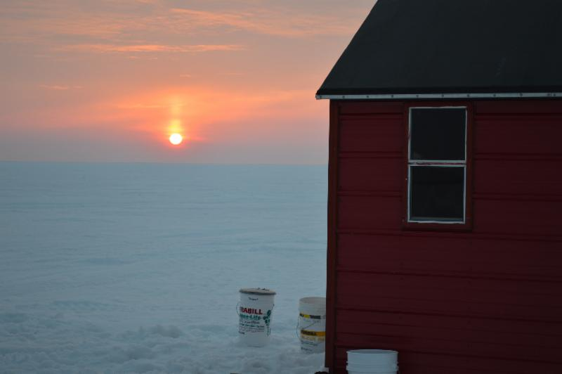 Ice fishing, sunset, Arnesen's fish house.
