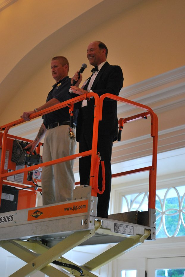VBA President Hugh Fain on scissors lift at reception