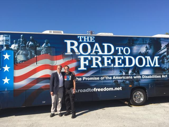 Matt and Tom standing in front of the Road to Freedom bus