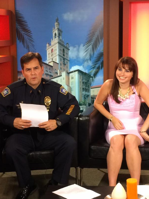 Lt. Barta and Haley Moss sitting in the filming studio and getting ready to film the 2nd Wallet Card Training Video.