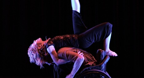 Two dancers, one in a wheelchair, perform a dance routine