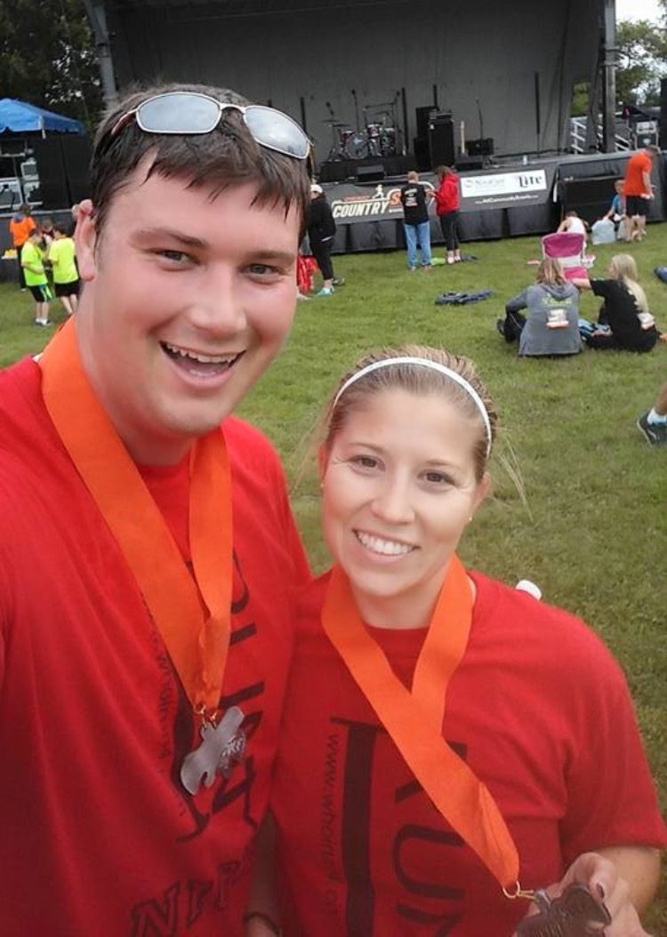 Close up picture of Adam and Jen with their medals after the race.