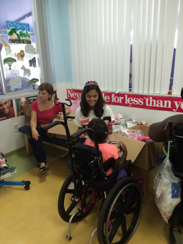 Amy and Claudia passing out gifts donated by Claire's.