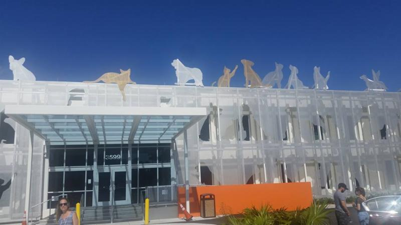 The front facade with cut out images of cats and dogs of the new animal services building in Miami, Florida.