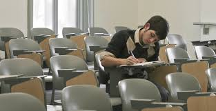 picture of a boy taking a test in an empty room