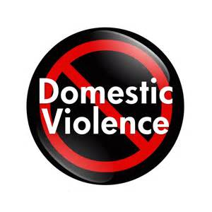 a black circle with the words Domestic Violence in white with a red slash across the diagonal
